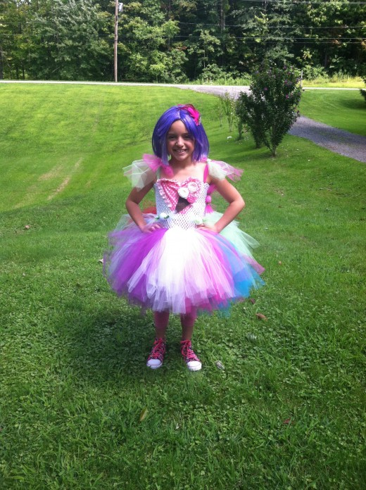 My daughter's California Girl inspired costume complete with a purple wig