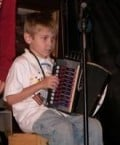 Six year old playing the accordion.