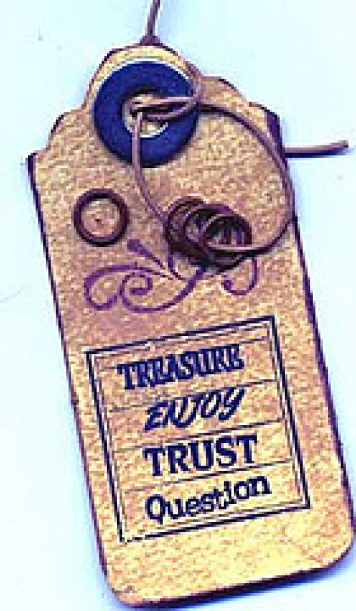 Distressed Tag Trimmed with Metals, Leather and Stamping