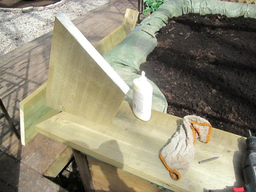 Hot tub planter: gluing the top frame together. Photo by timorous