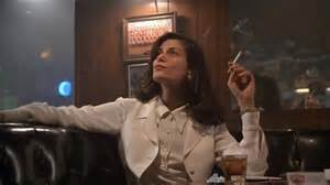 """""""Wendy Kroy"""" enjoying a cigarette in the bar in The Last Seduction"""