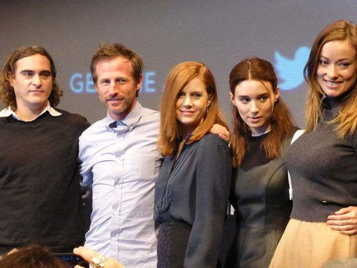 The cast of her at the premiere. Joaquin Phoenix is on the left next to director Spike Jonze. Amy adams, Rooney Mar and Olivia Wilde are also pictured.