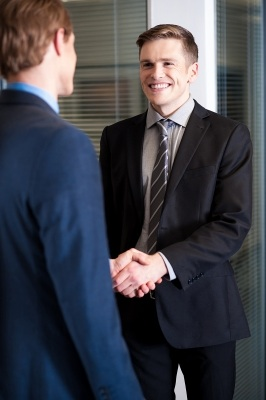 """Corporate Guys Shaking Hands"" by StockImages"