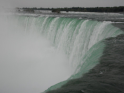 Canada has the better view.  The behind the falls tour is really cool!