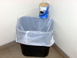 The coffee can is chock full of  rubbish!  I emptied out the complete contents of the wastebasket into it.
