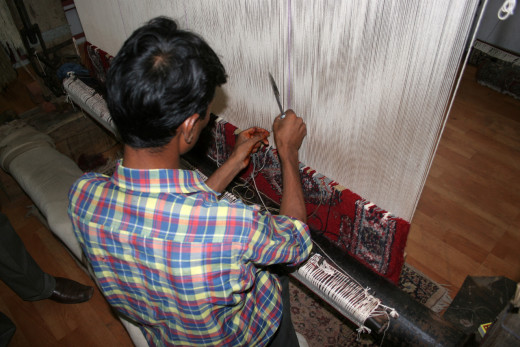 Agra artisan working on a hand made rug.