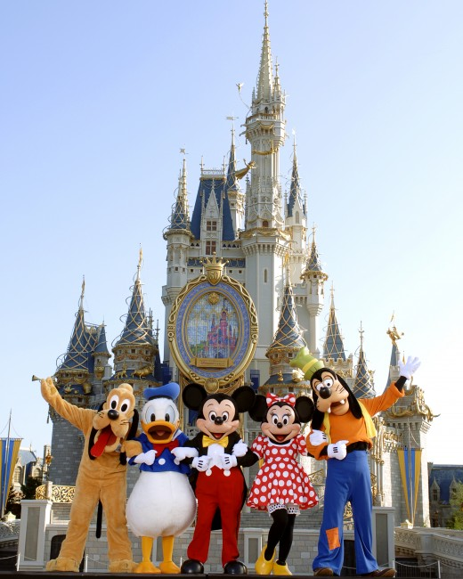 The Fab Five (L to R: Pluto, Donald Duck, Mickey Mouse, Minnie Mouse, Goofy) in front of Cinderella's Castle in Walt Disney World, Orlando, FL