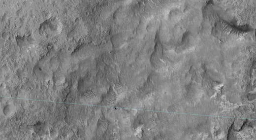 Mars Curiosity rover (white square on aqua line) drives out of basin (to the right).
