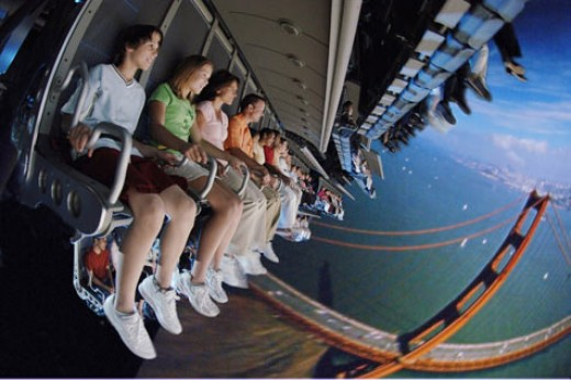 Soarin' in Epcot. Paraglide over beautiful landscapes all over the world and take in the sights, sounds, and smells of the aerial view.