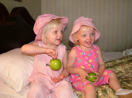 Sweet little girls with apples