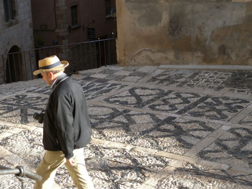 Gary is walking along this exquisite pavement in front of the church.  It is in the walled city of Montblanc.