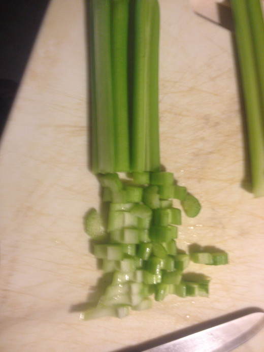 Cut your celery and add it to the baking pan