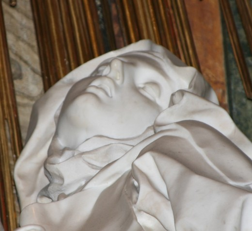 A close up of St. Theresa's face from the Bernini sculpture.