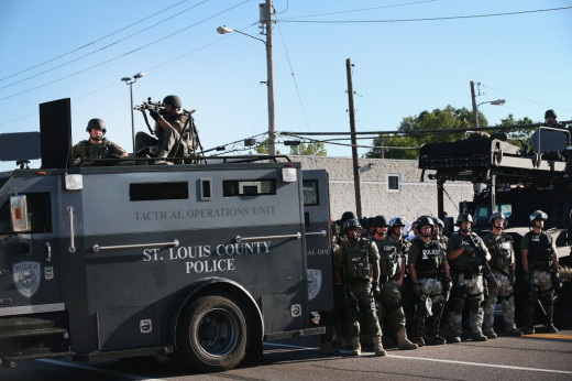 Image of police decked out in their military gear during Ferguson riots.