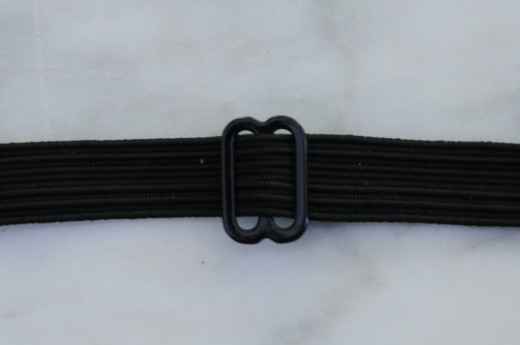 Adjustable fitting for the neck tie.