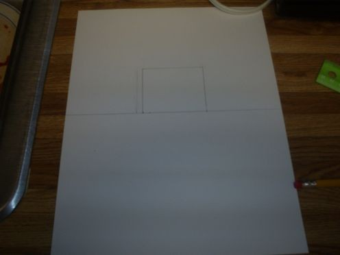 Use a ruler to draw a small box on the top have of the pop-up card.