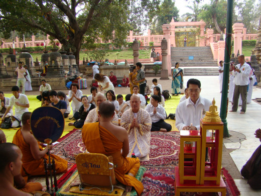 Monks Being Ordained Beneath The Bodhi Tree, Bodh Gaya. The Jewelled Walk In The Background