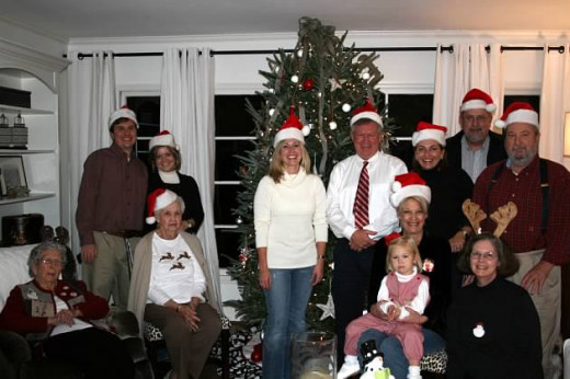 My cousin's family enjoys wearing Santa Hats at Christmas.  Isn't this a fun picture?