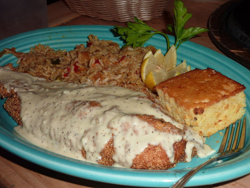 Fried catfish with rice and cornbread.