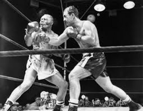 Rocky Marciano knocked Jersey Joe Walcott out in the 13th round with a powerful right hand to win the  heavyweight championship.