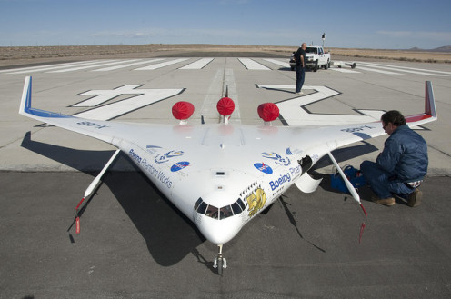 NASA engineer Gary Cosentino prepares the X-48B for flight. Researchers used the remotely piloted subscale X-48 hybrid/blended-wing-body (BWB) aircraft to explore concepts for cleaner, quieter commercial air travel.