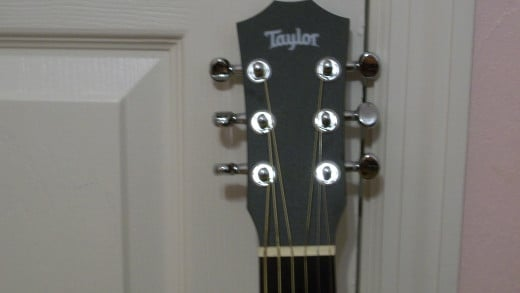 This photo shows the encased chrome tuners.