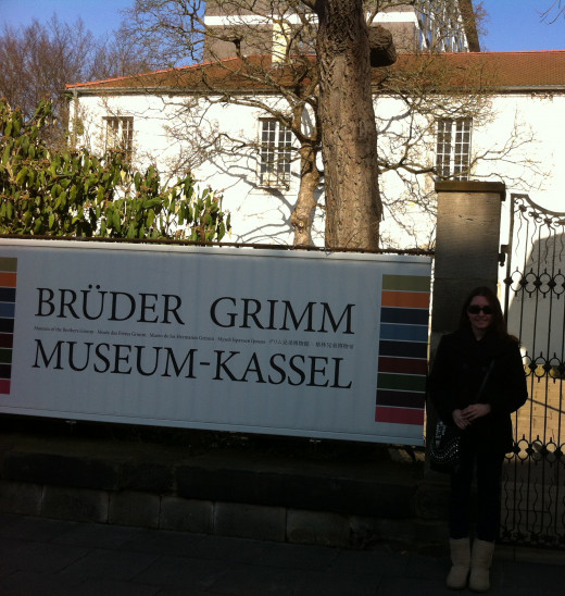 Me standing next to the Brothers Grimm Museum sign