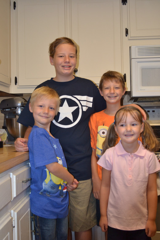 Sam is now in the second grade. This is a picture of him with his brothers and sister on the first day of school 2014.