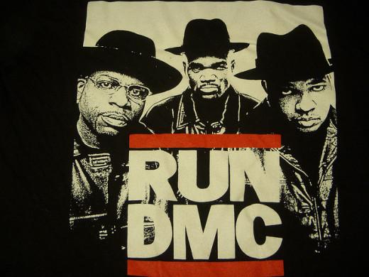 Iconic pioneering rap group Run-DMC, with Jam-master J (DJ) and MCs DMC and Run.