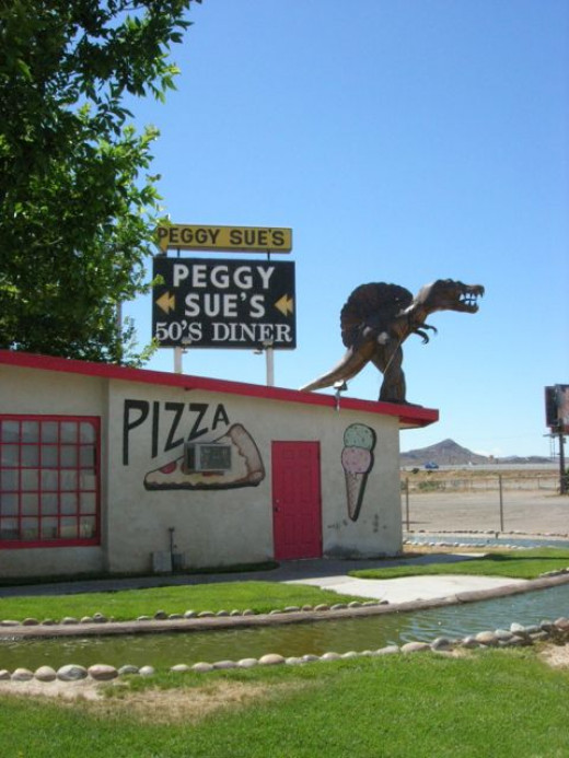 This smaller guy is up on top of their pizza parlor.