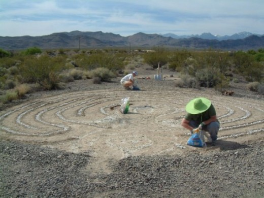 Here is then-priestess Anne Key and volunteer Calyxa working to etch the labyrinth lines with pickaxes and then fill in the trenches with marble chips.