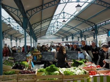 The Saturday market in Chartres, France has a wonder shade structure that is permanent.