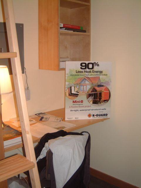 A built-in desk adjacent the ladder.
