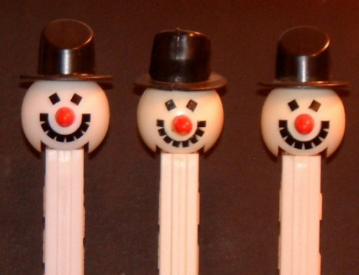 """The snowman design was recently updated too. In the oldest styles, he has teeth that are distinct pieces of plastic. Some newer versions of the """"old"""" snowman has a mouth that is one connected piece."""