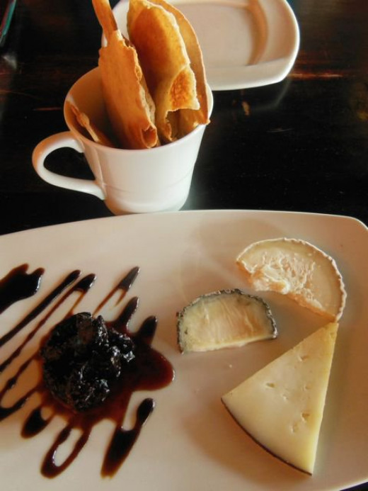 Here is a trio of cheese, paired with some simple crackers and a fancy drizzle of balsamic reduction.