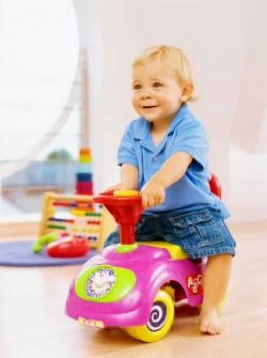 One Year Old Boy on a Ride-On Toy