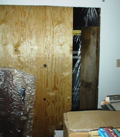 This picture of where the sliding door usually is was taken at night. The large hole in the wall was covered with as much plywood as we had on hand (you never plan this sort of emergency) with thin, clear, plastic covering the rest of the hole. The w