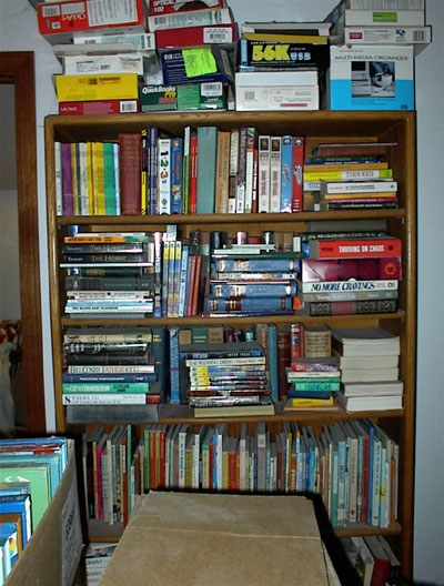 This is the big bookcase against the wall. I'm taking the picture from as far back as I can get toward the opposite wall. You can see a few of the other book boxes that have not been moved yet in the foreground on either side. This is the case I had