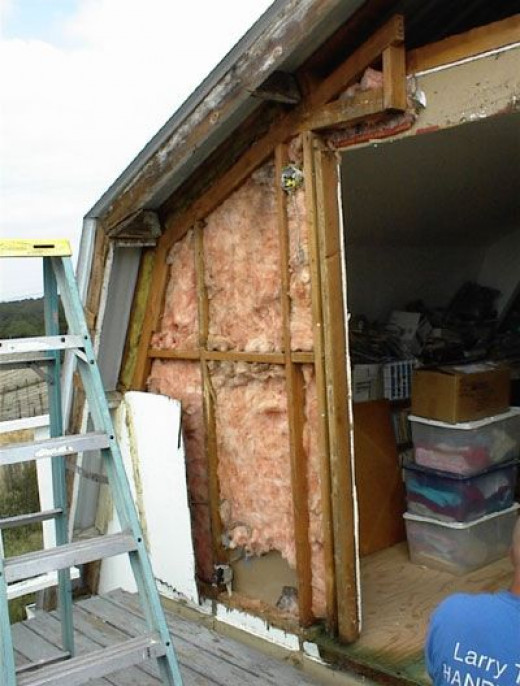 This shows the exposed insulation inside the wall. It will need to be covered with tar paper and then with the siding.