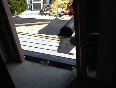 Through the doorway you can see the tar paper they will measure and cut on the balcony.