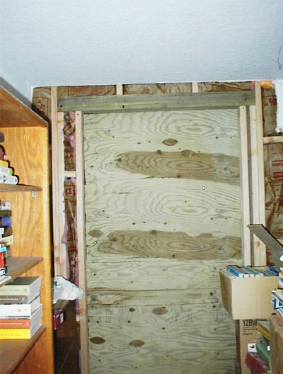 I have a certain fascination with looking at what's inside the walls and under the floor. You can see inside the walls around the door frame here.