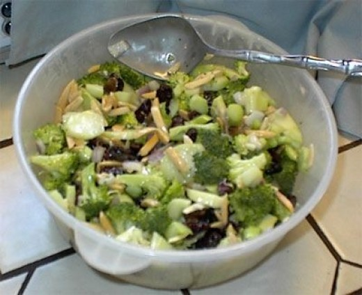 Pour dressing over salad and mix until all ingredients are moistened with the dressing. If you like, put into an festive serving dish and store in the refrigerator for at least 1-2 hours. It's even better if it sits until the next day. If you are in