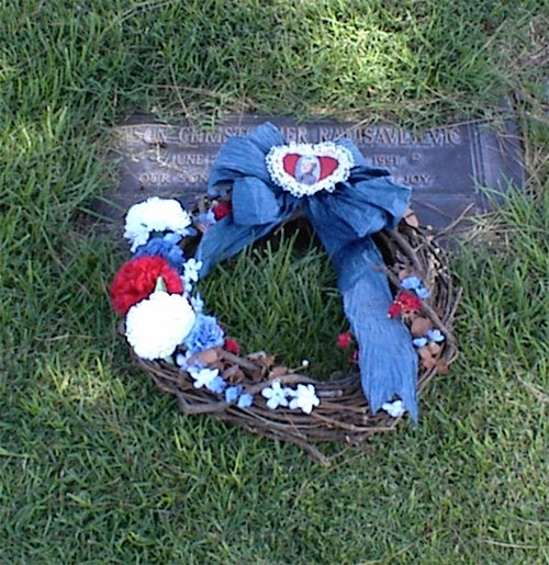 I placed Jason's wreath, made by our dear friend Sally Losey, on his grave in 2003 after it had hung on our kitchen wall for twelve years. It was time to let it join him.