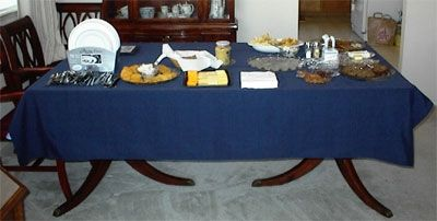 The table is set with snacks for guests who arrive early. The hot food will be set out closer to meal times.
