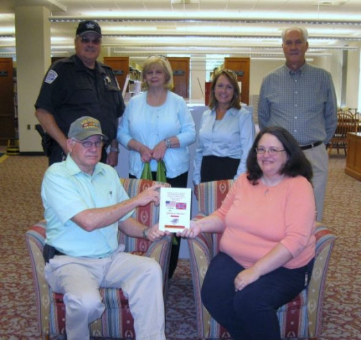 Jimmy Manley presents book to Anderson County Library