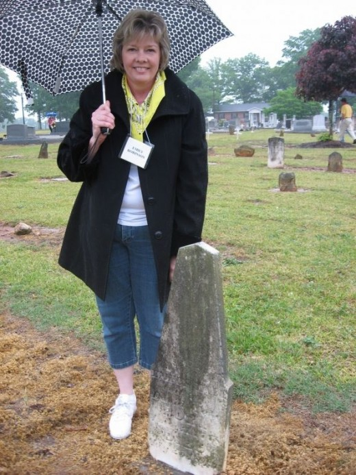 - Emily Davis Robinson poses at the headstone of her Great, Great, Great, Great Grandmother. The rain did not keep 8 of the Tate Family away from exploring around the Flat Rock Presbyterian/Baptist Cemetery looking for Emily Davis Tate's marker.Emil