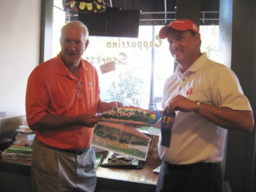 Chris Hardy and his Clemson Area Chamber cake with Danny Ford