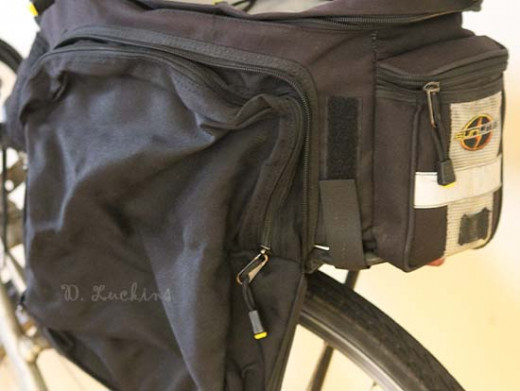 View of the back side of the rack with reflective tape.  That little pouch holds a lot of tools!  Excuse the dirt, this bag and bike is well used.