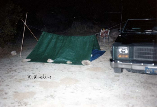 Here's another photo of my car supporting a tarp tent out in the desert.