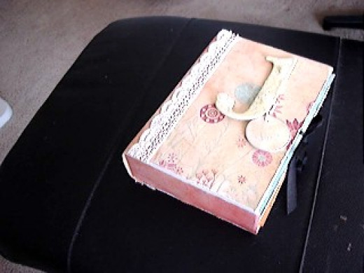 Traditional baby keepsake books like this one are certainly beautiful.  But, they can be a ton of work!